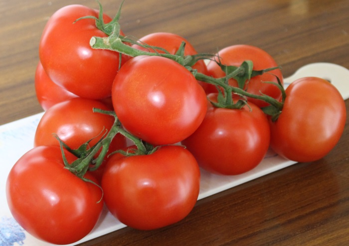 Wat is de prijs van tomaten?